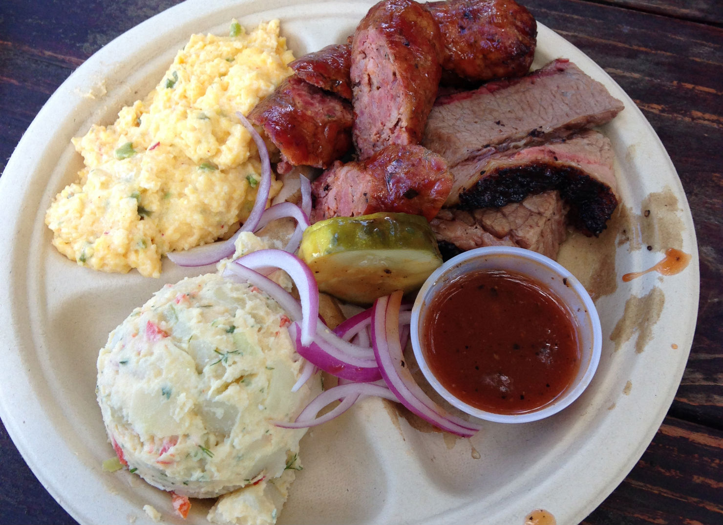 Brisket, kielbasa, jalapeno cheese grits & potato salad from Micklethwait Craft Meats